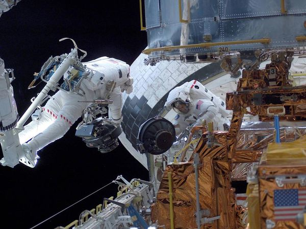 Astronouts Servicing The Hubble Space Telescope