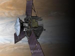 Artists Concept of Juno Spacecraft Orbiting Above Jupiter